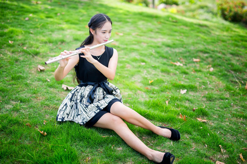 Chinese girl playing the flute
